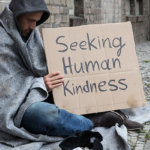 homeless man on street needing help